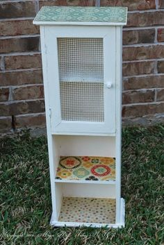 Mod podge gives new life to little cabinet. See how easy it is to decoupage decorate papers onto furniture.
