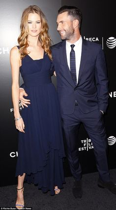 He is smitten: Adam Levine only has eyes for fiancée Behati Prinsloo at the Saturday premiere of his film Begin Again in New York City.  At the event the 35-year-old Moves Like Jagger singer told UsWeekly, 'She makes me the best person I can be. She's the best in the world.'