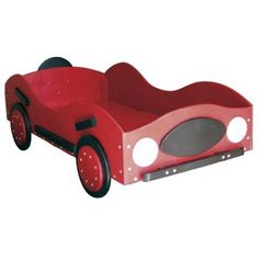 The New-Style Race Car Toddler Bed provides all the flair of a sleek racer without the maintenance and the noise. It's perfect for those transitional years when your little one is getting too big for the old crib. It's also easy for your child to get into with its low entrance. Hand-crafted with imported laminated Baltic Birch this bed available in red or blue has been carefully constructed to make it easy to get into but hard to fall out of. Dim