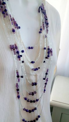 Check out this item in my Etsy shop https://www.etsy.com/listing/259370269/multiple-strand-necklace-long-purple
