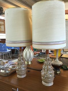 Vintage ceramic and wood lamps. More info? Email midmodcollective@gmail.com