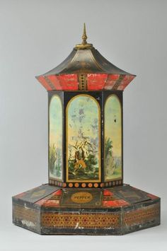 GENERAL STORE VICTORIAN SPICE CABINET 1870-1880, lithographed tin, features individual spice cabinets with hand painted hexagon in colorful reliefs, removable top for filling tin, very rare example, dramatic scale and presence.