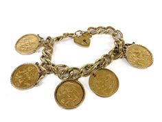 A 9ct gold curb link bracelet with padlock, with five Sovereign channel set charms. Sold for £1300