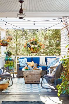 Seasonal Touches:  Round zinc baskets from Terrain are lined with sheet moss, then filled with soil and dried angel vine, which, like a flower frog, helps hold things in place. From there, anything goes on this Connecticut home's porch.