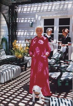 CZ Guest in her own fuschia vintage velvet and satin Mainbocher evening coat shot by Mario Testino for US VOGUE August 2002.