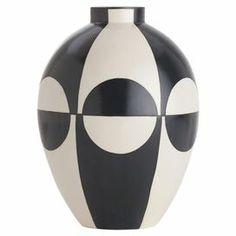 "Porcelain vase with a geometric motif.  Product: VaseConstruction Material: PorcelainColor: Black and ivoryDimensions: 12.5"" H x 9"" Diameter"
