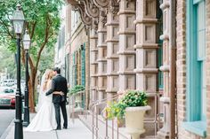 Charleston Wedding pictures outside the Dock Street Theater in the French Quarter by Aaron and Jillian Photography » Husband and Wife Wedding Photographers based in Charleston, South Carolina.