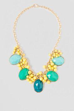 Olivia Statement Necklace. The vivid shades of teal & yellow beads make for an eye catching statement necklace. Wear with a silk blouse and shorts for a fun night out with the girls.