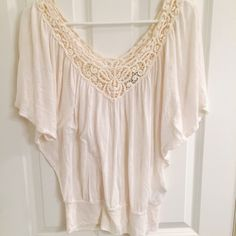 Cream lace baggy top This is only worn once. It has a lace sort of design on the top in the front and back. I do bundles for discounts, please use the offer button if you're questioning a lower amount, no trades Forever 21 Tops
