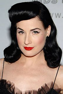 """Makeup of the 40s  The women of the 40s were known as """"naturally beautiful"""" - soft and feminine. The old Hollywood look is one that a lot of women recreate, like Dita von Teese!      HOW TO:  1. Apply foundation as usual (your skin tone).  2. Shape and define your eyebrows with a brow pencil or powder - they should be perfectly arched.  3. Apply sheer eyeshadow. Don't make it too heavy because the 40s are focused heavily on the lashes.  4. Curl your lashes and lightly coat your lashes with…"""