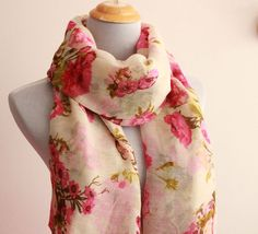 Brand New - White Scarf with Floral Prints. Picture has pink hue but actual item is whiter    can be worn for a casual look. Soft and genuine.