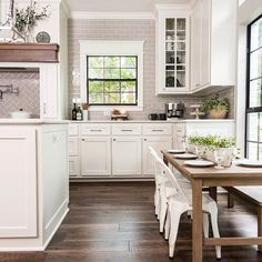 We love the unexpected use of this traditional style mantel above the stove in the Bufton's kitchen. Also, that kids table has us dreaming of tiny dinner parties. #FixerUpper