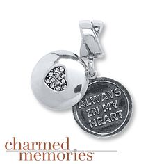 "This darling dangle charm from Charmed Memories® features a sterling silver disc adorned with a heart styled in clear SWAROVSKI ELEMENTS. The disc slides to the side to reveal a second disc with the words ""Always in my heart."""