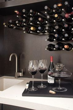 Wine-holder posts specially fabricated for this wall project.  Contemporary  by NOTION, LLC
