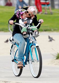 I totally prefer this style of bike riding with your kids! Much better than having them behind you!