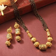 22 carat gold four line mangalsutra chain with nakshi balls pendant paired with antique nakshi earrings by Manubhai jewellers. Gold Mangalsutra Designs, Gold Earrings Designs, Gold Jewellery Design, Necklace Designs, Jewellery Diy, Mangalsutra Simple, Jewelry Making, Gold Designs, My Princess