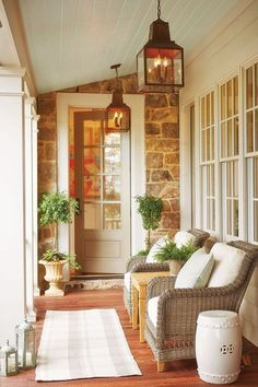 Light blue painted porch ceiling paired with white and tan furnishings and home exterior.