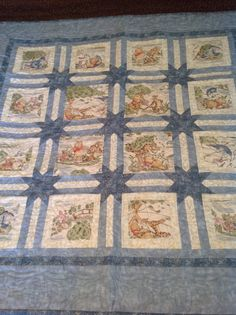Winnie the Pooh quilt. Blue/baby boy infant quilt. Stars in sashing setting.