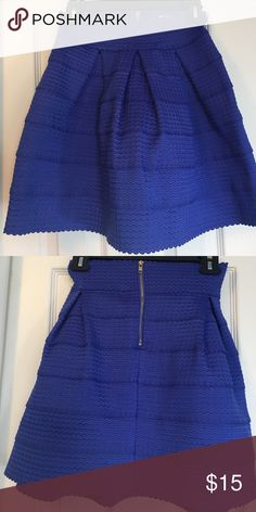 Bandage style skirt Deep periwinkle in color. Thick material, stretchy. Very cute and appropriate length for the office Francesca's Collections Skirts Midi