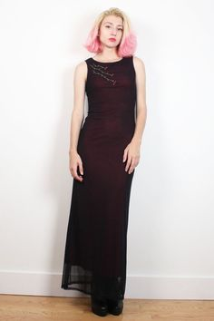 Vintage dress. Sheer, black mesh outer layer. Burgundy, stretch lining. Floral embroidery at chest front. No closures. Maxi length.   Shoulder Width:  Bust: 31-38 Waist: 24-32 Hips: 32-40 Length: 57 (lining is 52) Tag: Rampage. S. Fits Like: XS/S  Accessories are not included unless listed in the item description For reference the model is 57, and a US size 2.     **PAYMENT/ SHIPPING/ REFUNDS/ SIZING: Please review my shop policies before buying. Thank you…