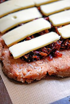 Bacon Jam and Fontina Loaded Turkey and Rice Meatloaf - this ground turkey and steamed rice meatloaf gets an added flavor boost from a red onion, cider vinegar bacon jam and fontina cheese filling all rolled up inside.