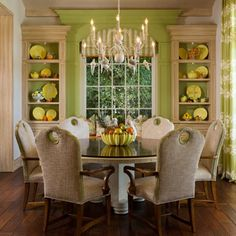 love every inch! Perfect.  Birds on the chandelier.. Green trim, yellow accents and those chairs!