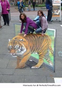 Amazing 3D art tiger is almost real – It looks like the tiger is coming out of the televison.
