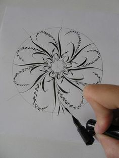 Delicate mandala construction tutorial with pointed pen. Starts out with tracing a roll of masking tape
