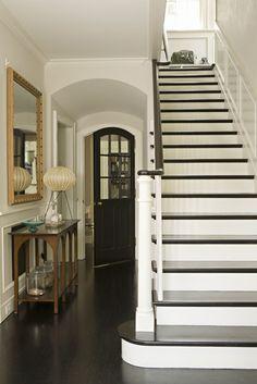stairs and black door