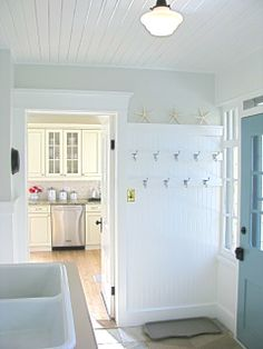 Two staggered rows of hooks and boot tray below. - Anyone Can Decorate: Great Mud Rooms and Organized Entry Spaces
