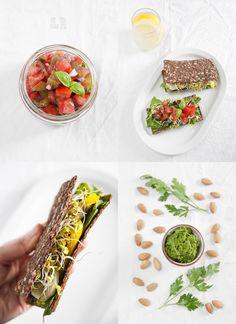 Fully raw vegan breakfast. Raw bread with parsley-almond pesto and tomato-plum salsa.