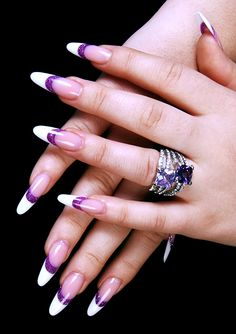 Long French nails with round tips and thick purple line