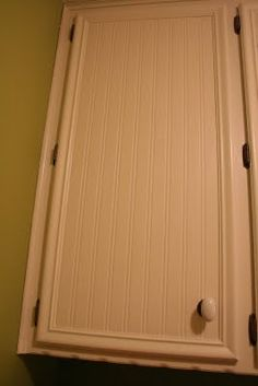 transform old cabinets and even CEILINGS with beadboard wallpaper.