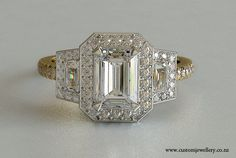 Yellow Gold and White Gold 3-stone Emerald and Trapezoid Halo Engagement Ring New Zealand