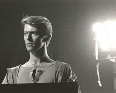 "DAVID BOWIE - 1978   Original Tom Robe photograph 10""x8"", signed by Tom Robe. Original photograph taken on the 1978 Isolar II world tour, almost certainly at Toronto's Maple Leaf Gardens on May 1st. Judging by the lighting rig, Bowie is probably captured here playing 'Warsawa', the show opener, on a synthesiser positioned off centre stage."