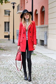 Pair a red coat with black leather leggings to achieve a chic look. Black leather booties will bring a classic aesthetic to the ensemble.  Shop this look for $187:  http://lookastic.com/women/looks/hat-turtleneck-coat-tote-bag-leggings-ankle-boots/5764  — Black Wool Hat  — Grey Turtleneck  — Red Coat  — Red Leather Tote Bag  — Black Leather Leggings  — Black Leather Ankle Boots