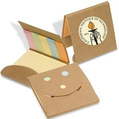 "Pocket sized recycled cardboard cover with die-cut smiley face. Includes one 3"" x 3"" sticky note pad and five sticky page marker strips. Price includes one color, one location Pad imprint on front flap. Product Dimensions: 3-1/4""W x 3-1/4""H x 1/4""D closed."