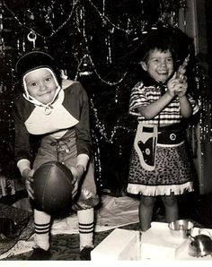 Vintage Christmas photo ... Such smiles on the children's faces! They got what they asked Santa for.