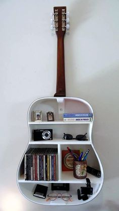 This is a wonderful way to recycle your old guitar - By doing this we can store lots of things that might take too much space in your room- I think this is a fantastic idea to decorate but also organise your room- follow me on Pinterest to find out more ideas (jania)