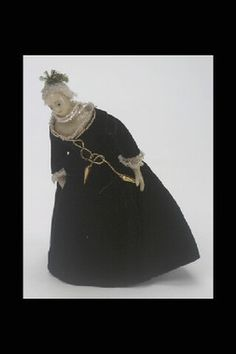 Wax doll from the late 18th century.  The black dress is probably a later addition.