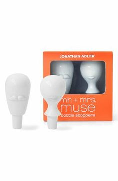 "Jonathan Adler Mr. & Mrs. Muse Bottle Stoppers by Jonathan Adler. $48.00. By Jonathan Adler; imported. Approx. Porcelain; hand wash. dimensions: 3 3/4""H x 1 1/2""W. The perfect duo to complete your Surrealist table-scape. Pair them with our Mrs. & Mrs. Muse salt and pepper shakers for a tres moderne gift. It's packaged for easy gifting.Product Measures: (Mr. Muse) 4"" high (Mrs. Muse) 3.5"" high (Gift Box) 5"" x 5"" x 3""Material: CeramicManufactured in: China"