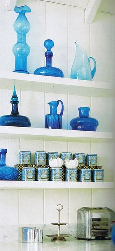 i love blue glass-- and these little tins (of what i do not know) are simply wonderful ~