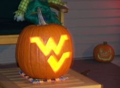 This is totally how I'm going to carve my pumpkins next year!!!     Halloween - WVU style.