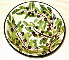 Olive salad bowl, a current pattern painted by Geoff Graham in Vallejo, California at Cinnabar Ceramics.  You can google the Cinnabar Ceramics Website if you want to know more.