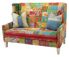 #2211 Settee --   Add  a bright burst of Bollywood to today's décor with these delightful settee and ottoman designs. Covered in Kantha cloth, a recycled, repurposed antique sari cloth from India, no two designs are alike.  So the whimsical style you select is uniquely yours and yours alone. That's because every piece of Kantha cloth is different. And, these fabrics have been hand-cut and sewn into one-of-a-kind patchwork patterns for each piece.  www.massoudfurniture.com