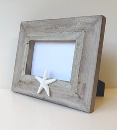 Beach Cottage decor...photo frame with a starfish $39  http://www.etsy.com/listing/118578104/housewares-beach-cottage-photo-frame