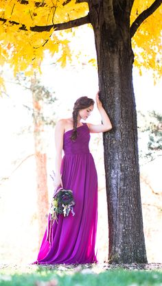 A gorgeous one-shoulder chiffon bridesmaid dress. Shown in wine.