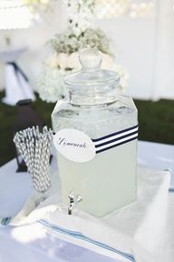 lemonade in glass beverage server; navy striped straws; navy striped ribbon; labels with nice navy font