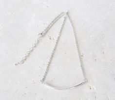 """Simple and classic. Perfect for layering with your other favorites. 2.5"""" silver bar on delicate chain. <br><br>Silver plated brass<br>Length: 8"""" + 2"""" extender"""