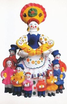 A Nanny with Children. It's a Dymkovo toy – a hand-painted clay toy from the Russian village of Dymkovo.